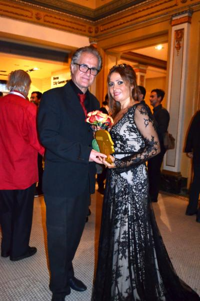 The Director Mehmet Eryılmaz and the Lead Actress of The Visitor Zümrüt Erkin with the Grand Prix Spécial du Jury.